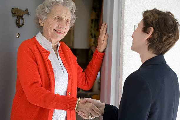 Senior woman at front door stock photo