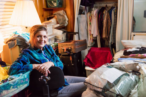 senior woman at home, messy room - hoarding stock photos and pictures