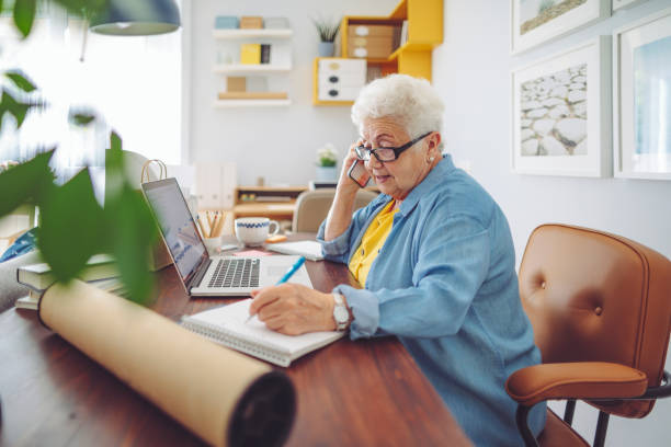 Senior woman at home Senior woman at home investor stock pictures, royalty-free photos & images