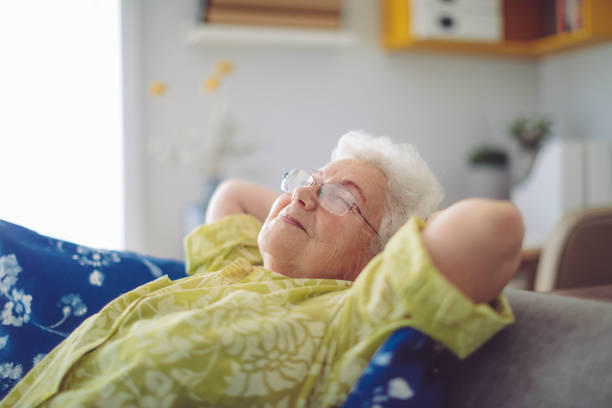 Senior woman at home Senior woman at home comfortable stock pictures, royalty-free photos & images