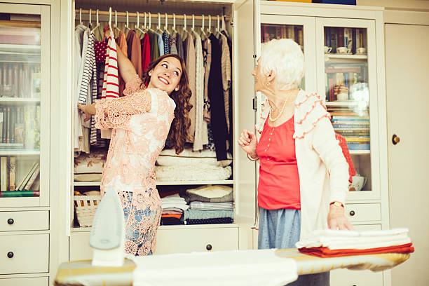 senior woman at home - arranging stock photos and pictures