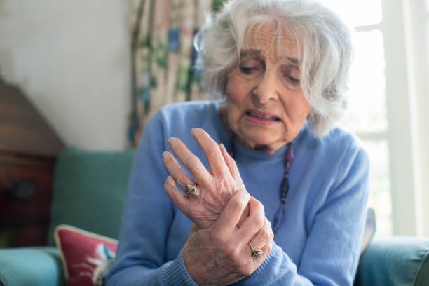 Senior Woman At Home Suffering With Arthritis stock photo