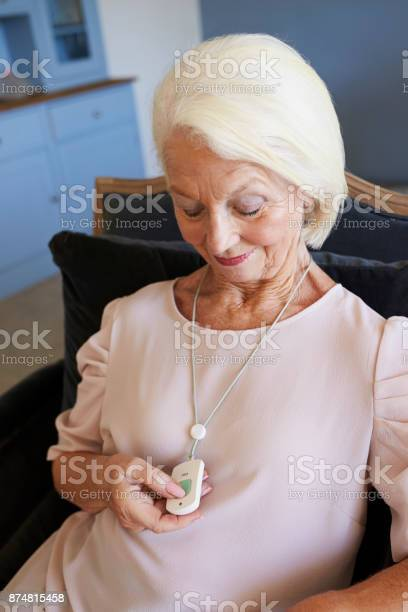 Senior woman at home using distress alarm call button picture id874815458?b=1&k=6&m=874815458&s=612x612&h=it74cp5zzg9x7 dz8kp9u dwmploq29dbzif6rkazck=