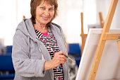 Senior woman at painting class.