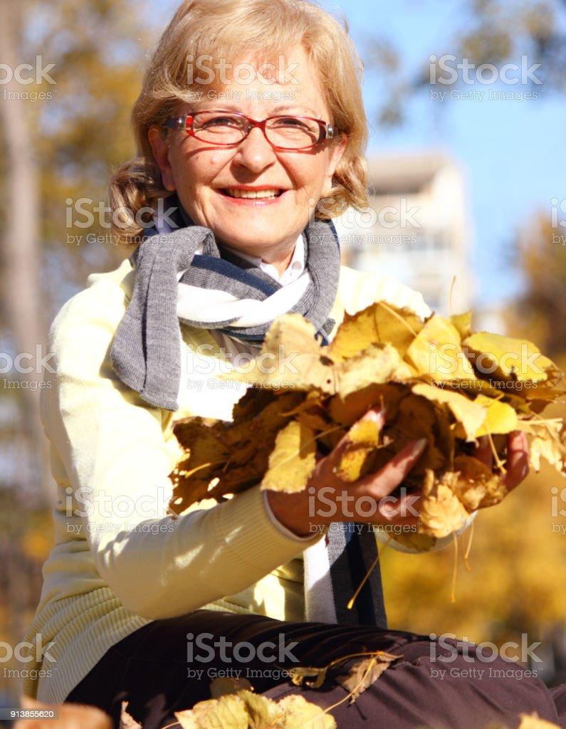 Senior woman at park stock photo