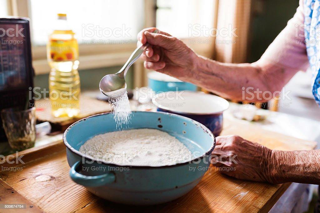 Senior woman baking stock photo