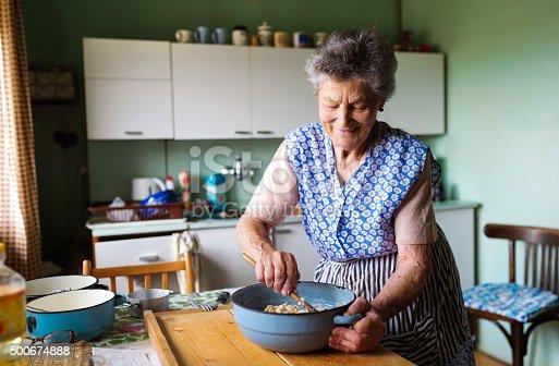 istock Senior woman baking 500674888