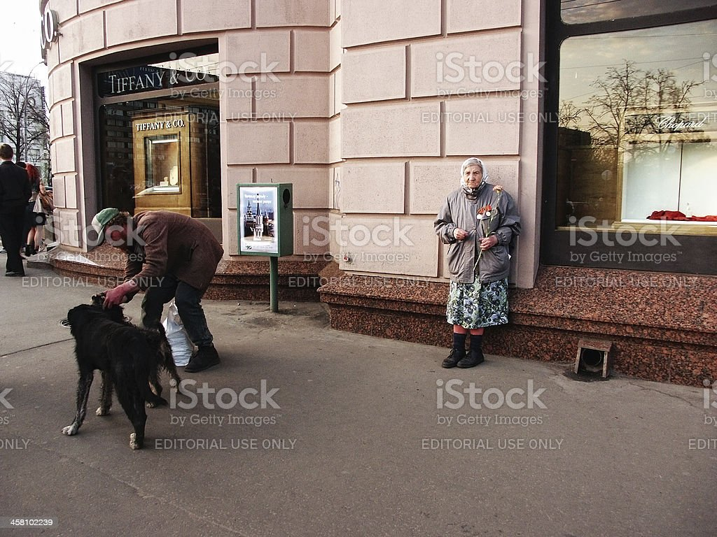 Senior Woman Begging on Central Moscow Street royalty-free stock photo