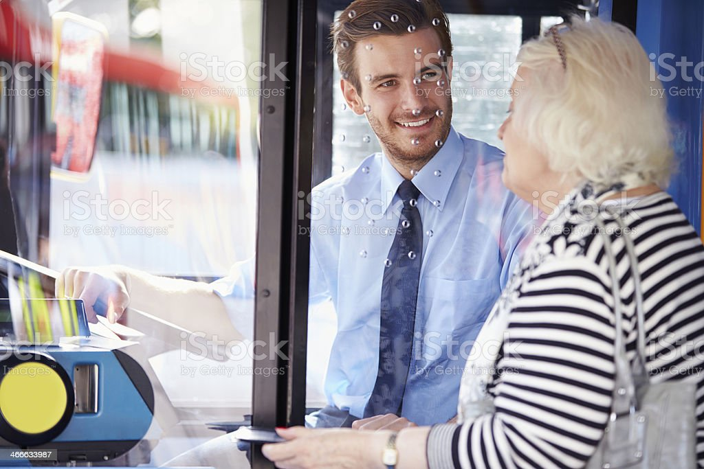 Senior Woman Boarding Bus And Buying Ticket stock photo