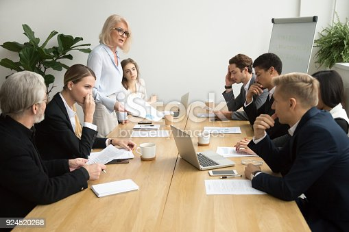 istock Senior woman boss scolding employees for bad work at meeting 924520268