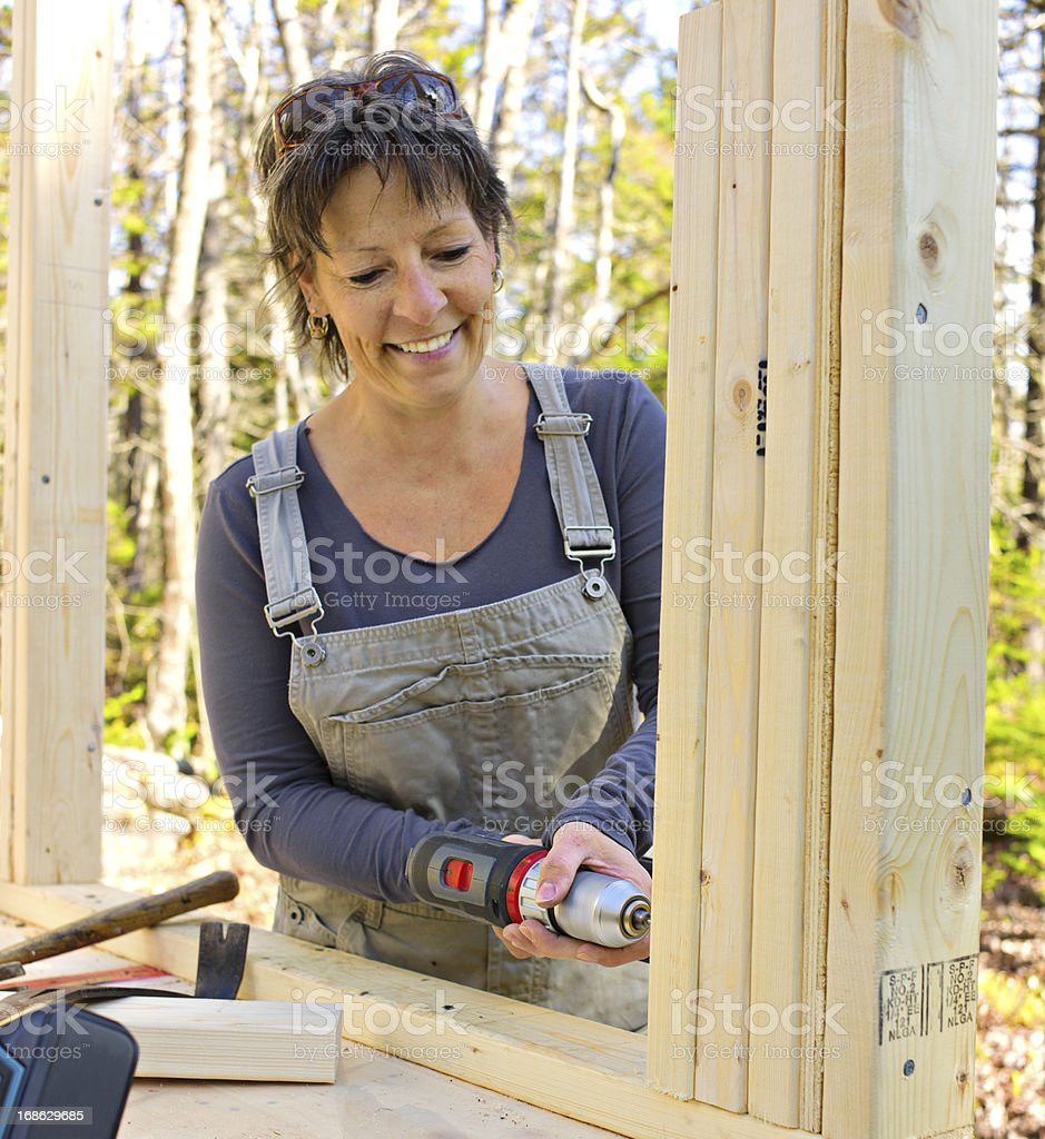 Senior Woman Builds Her Dream Cottage in Nova Scotia, Canada. royalty-free stock photo