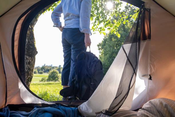 senior woman camping, in-out-zeltblick - zelt stehhöhe stock-fotos und bilder