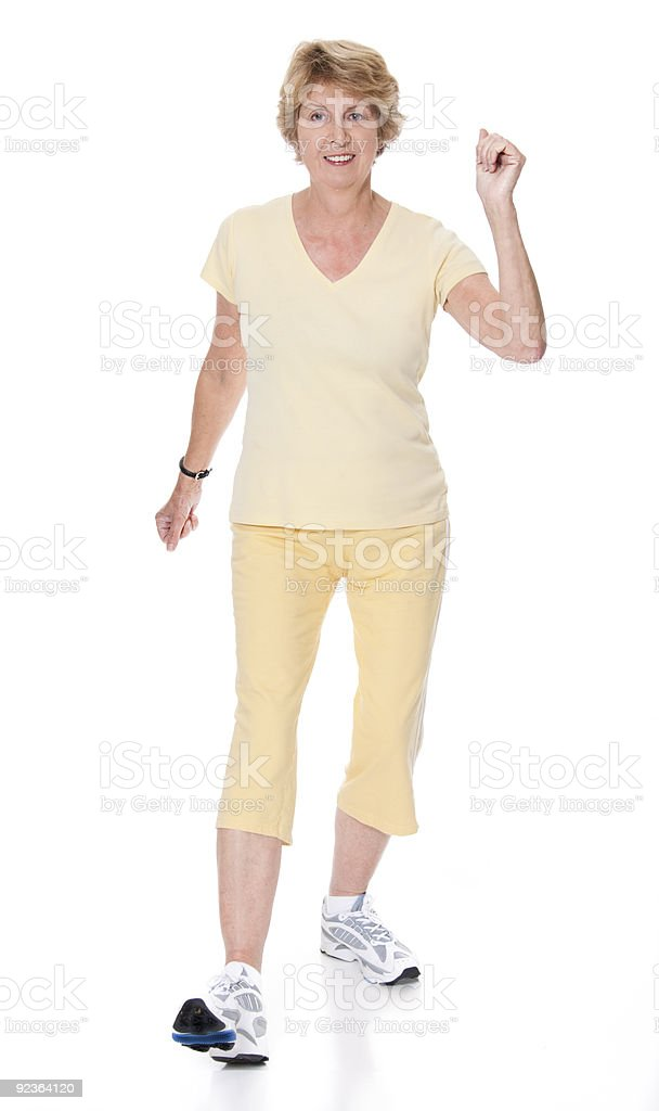 Senior woman carrying out exercise routine royalty-free stock photo