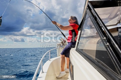 155674939istockphoto Senior Woman catching a fish 169944081