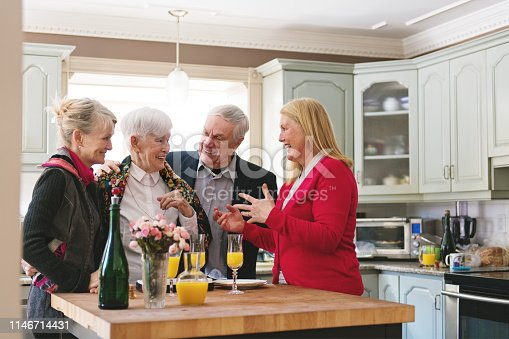 944372620istockphoto Senior woman celebrate mother's day with her family 1146714431