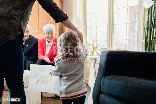 944372620istockphoto Senior woman celebrate mother's day with her family 943545676