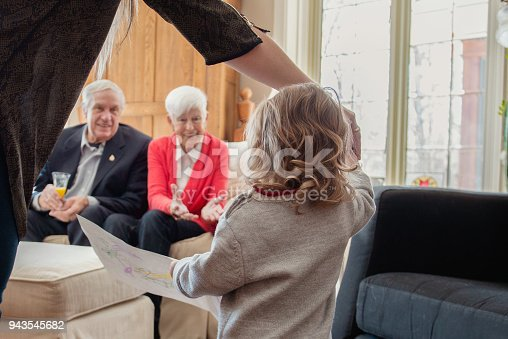 944372620istockphoto Senior woman celebrate mother's day with her family 943545682