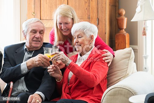 944372620istockphoto Senior woman celebrate mother's day with her family 943545684