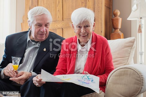 944372620istockphoto Senior woman celebrate mother's day with her family 943545734