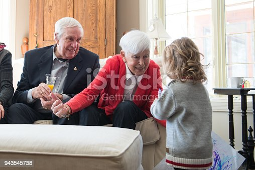 944372620istockphoto Senior woman celebrate mother's day with her family 943545738