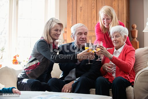 944372620istockphoto Senior woman celebrate mother's day with her family 943545850
