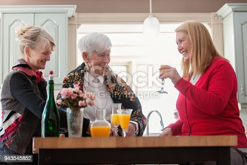 944372620istockphoto Senior woman celebrate mother's day with her family 943545852