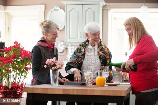 944372620istockphoto Senior woman celebrate mother's day with her family 943545854