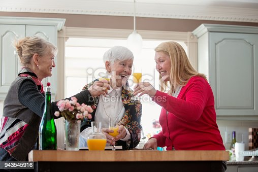 944372620istockphoto Senior woman celebrate mother's day with her family 943545916