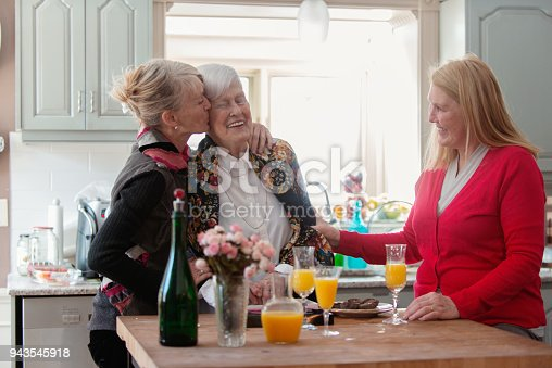 944372620istockphoto Senior woman celebrate mother's day with her family 943545918