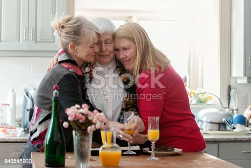 944372620istockphoto Senior woman celebrate mother's day with her family 943545920