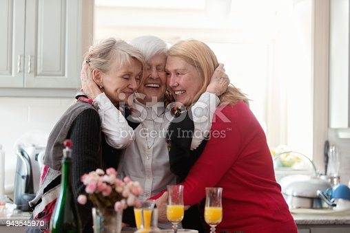 944372620istockphoto Senior woman celebrate mother's day with her family 943545970