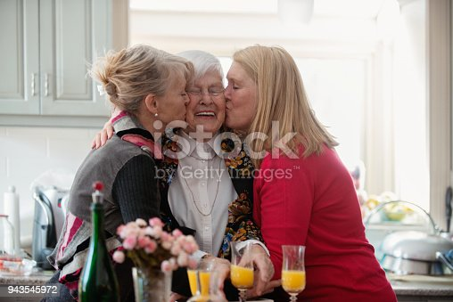 944372620istockphoto Senior woman celebrate mother's day with her family 943545972