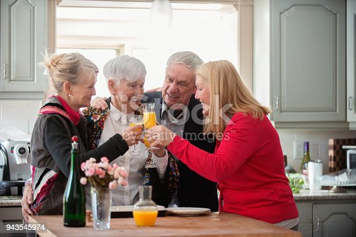 944372620istockphoto Senior woman celebrate mother's day with her family 943545974