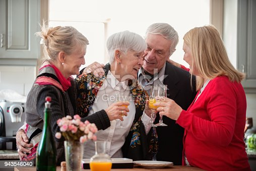 944372620istockphoto Senior woman celebrate mother's day with her family 943546040