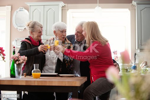 944372620istockphoto Senior woman celebrate mother's day with her family 943546062