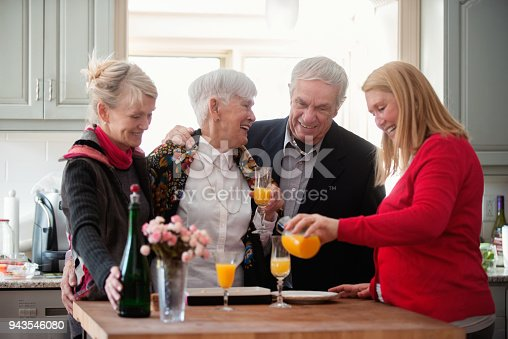 944372620istockphoto Senior woman celebrate mother's day with her family 943546080