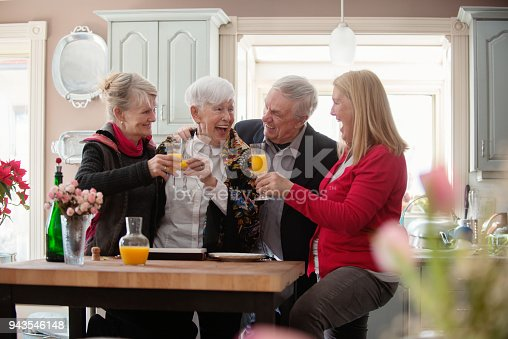 944372620istockphoto Senior woman celebrate mother's day with her family 943546148