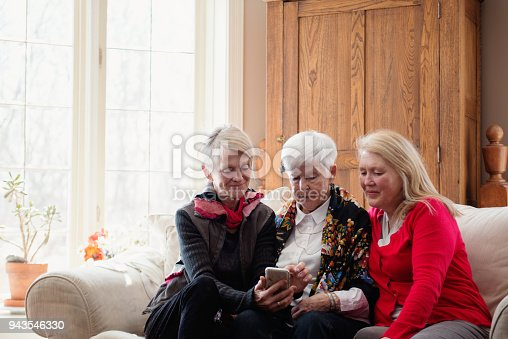 944372620istockphoto Senior woman celebrate mother's day with her family 943546330