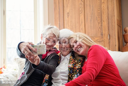 944372620istockphoto Senior woman celebrate mother's day with her family 943546362