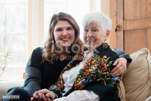 944372620istockphoto Senior woman celebrate mother's day with her family 944372414