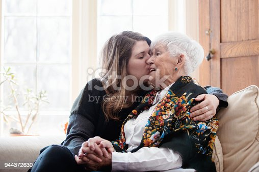 944372620istockphoto Senior woman celebrate mother's day with her family 944372630