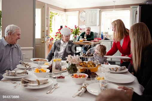 944372620istockphoto Senior woman celebrate mother's day with her family 944373686