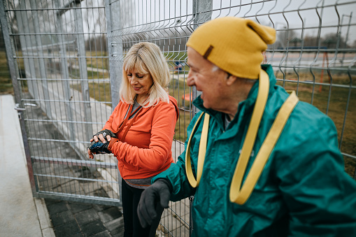 Senior woman checking heart rate monitor after training
