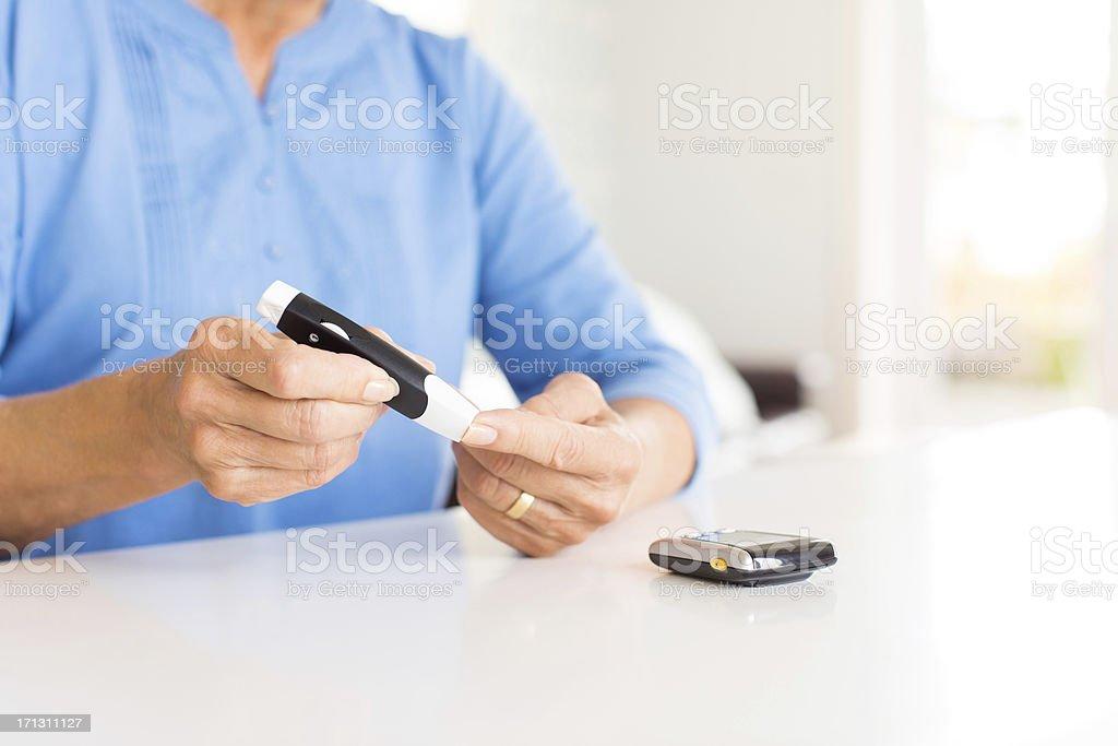 Senior Woman Checking Her Blood Sugar Level. royalty-free stock photo