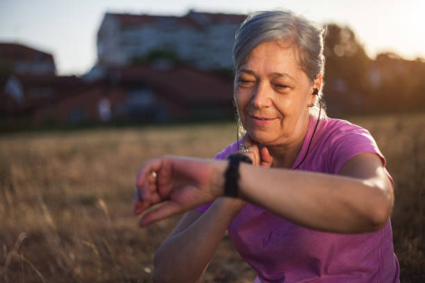Senior Woman Checking Her Pulse After Exercise Close up of Senior Woman Checking Her Pulse After Exercise woman taking pulse stock pictures, royalty-free photos & images