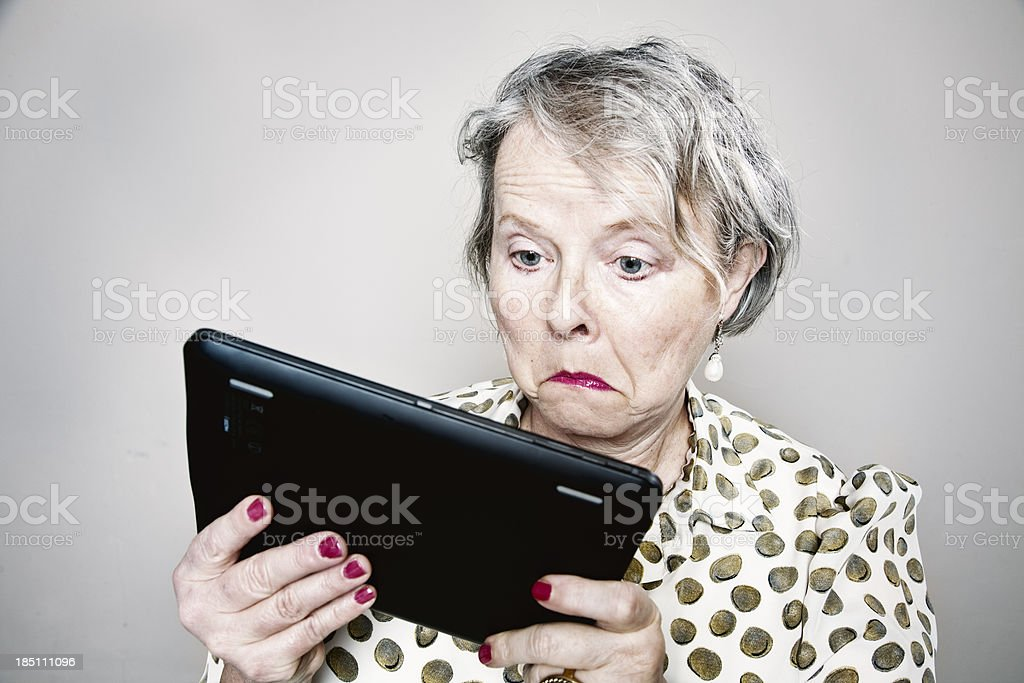 senior woman cluelees unhappy with tablet pc stock photo