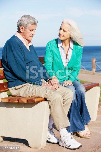istock Senior Woman Comforting Depressed Husband Sitting On Bench 177700117