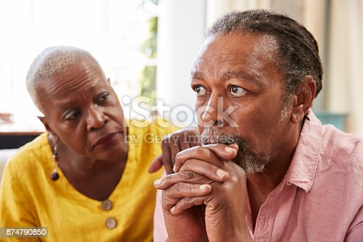 874789476istockphoto Senior Woman Comforting Man With Depression At Home 874790850