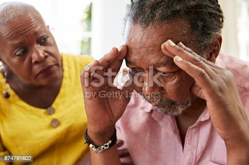 874789476istockphoto Senior Woman Comforting Man With Depression At Home 874791602