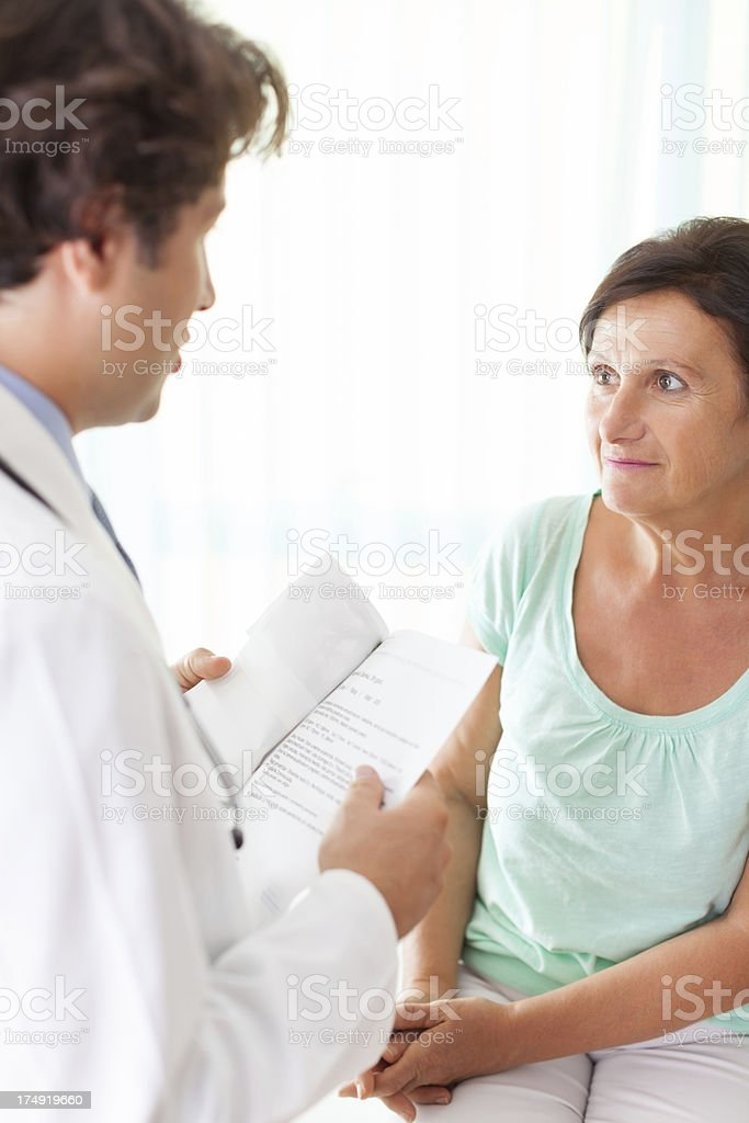 Senior woman communicate with doctor royalty-free stock photo